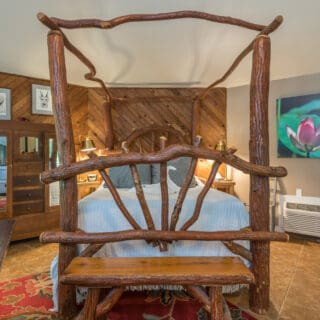 My Roundette features a handmade sassafras canopy bed.