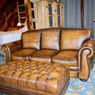 Comfy couch at the Garden Cabin - The Cove at Fairview - Vacation Rentals - Asheville, NC