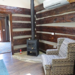 Wood burning stove at the Garden Cabin - The Cove at Fairview - Vacation Rentals - Asheville, NC
