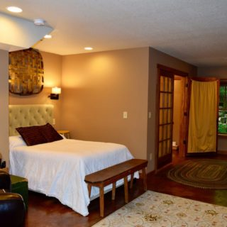 The Huntley Basement Bedroom features a Queen Bed - The Cove at Fairview- Vacation Rentals Asheville NC