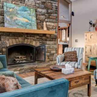 Our House living room has a fireplace and new furniture - The Cove at Fairview Vacation Rentals - Asheville NC