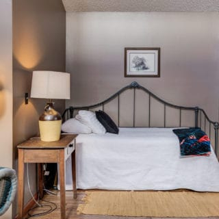 Our House living room has a day bed - The Cove at Fairview Vacation Rentals - Asheville NC